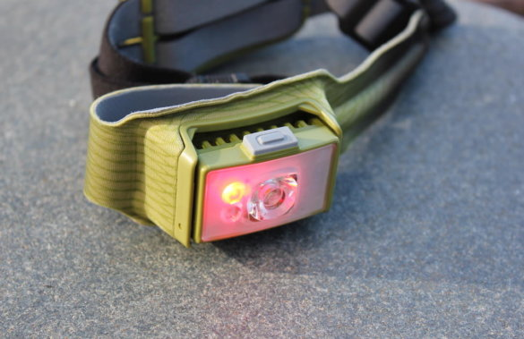 This photo shows the red light mode on the front of the BioLite HeadLamp 750.
