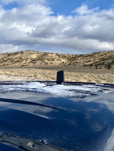 This photo shows the weBoost Drive Reach antenna placed on a pickup truck in a remote area of high-elevation desert during product testing and review in Nevada.