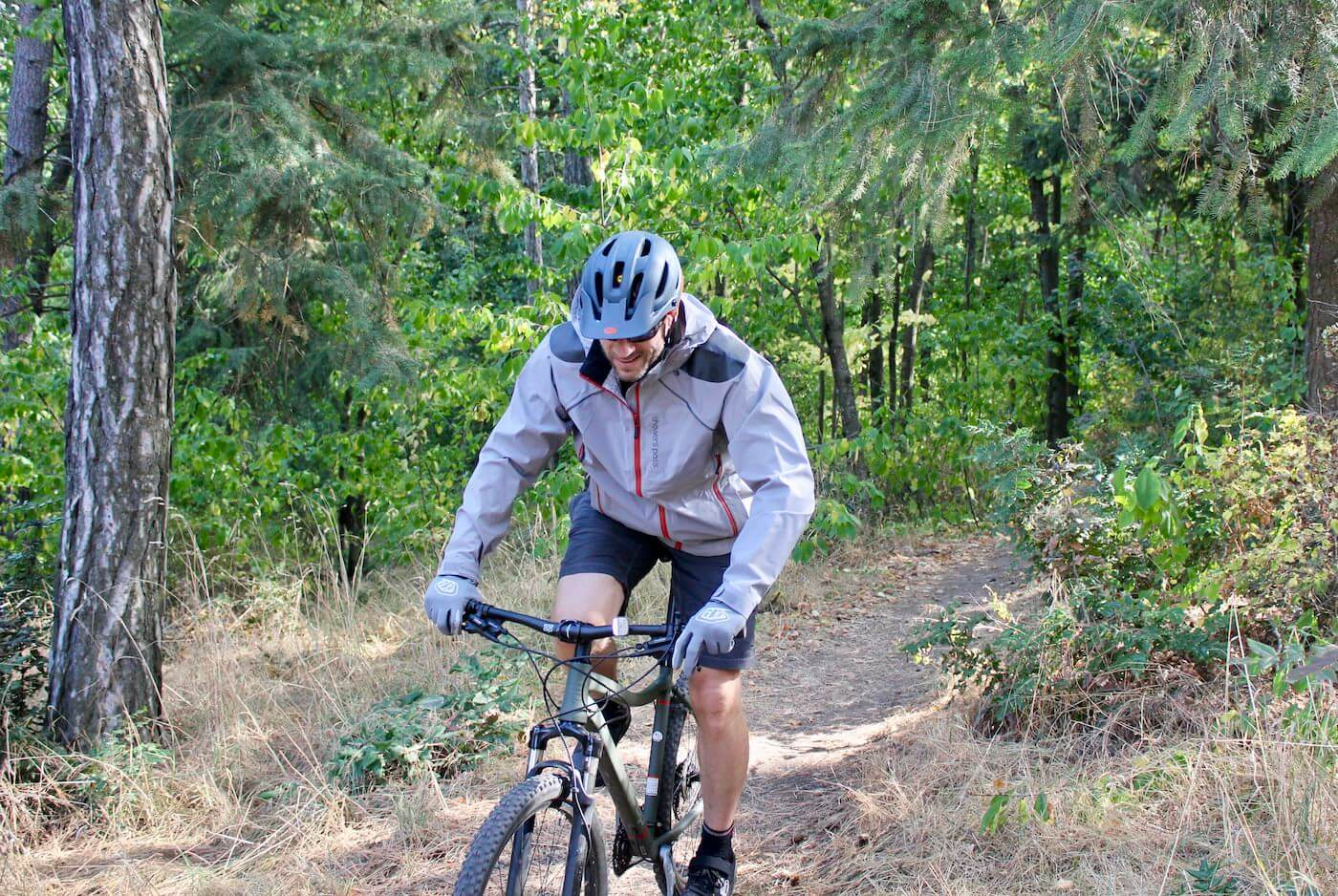 This photo shows the author wearing the Showers Pass Elements Jacket during testing during the mountain biking review process.