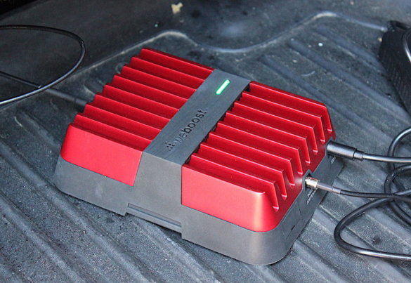 This review photo shows the weBoost Drive Reach base unit installed and powered on.