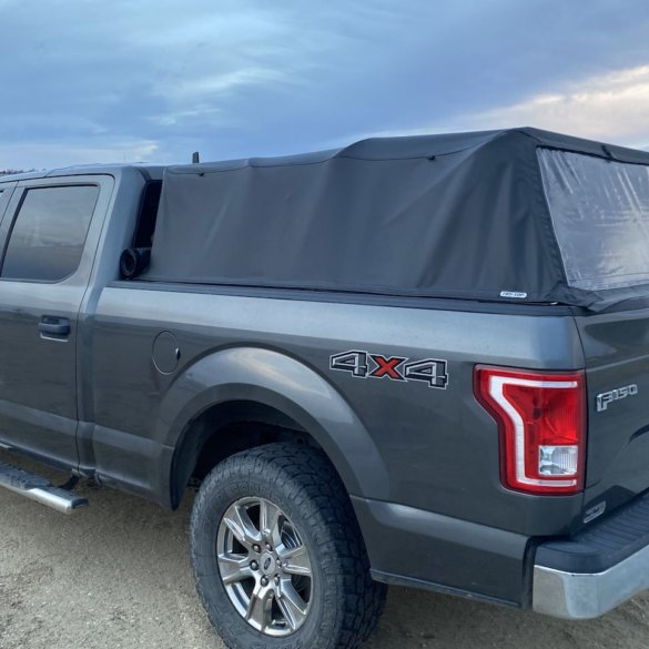 This review photo shows the Fas-Top Travel Package installed on a Ford F-150 pickup with the soft topper up.