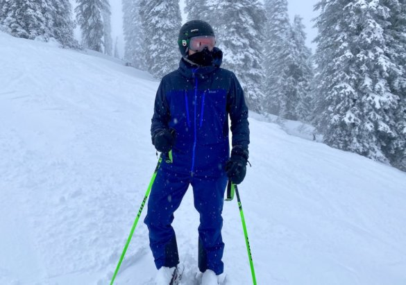 This photo shows the author wearing the Stio Objective Pro Jacket and Bib while skiing.