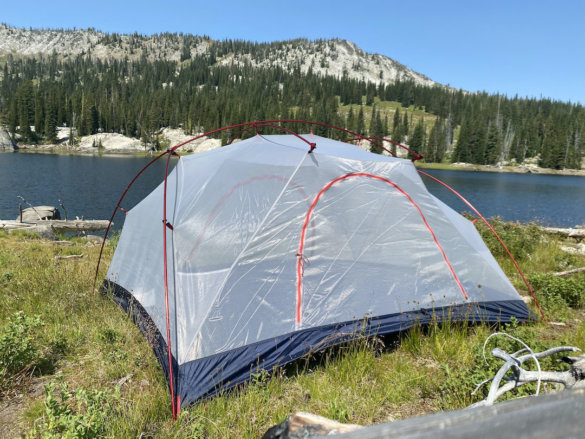 This review photo shows the L.L.Bean Mountain Light HV 3 Tent set up without the rainfly attached in the mountains near a lake.
