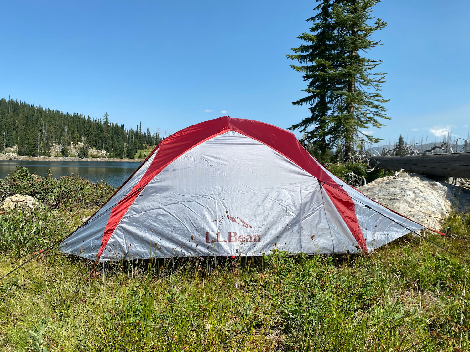 This review photo shows the L.L.Bean Mountain Light HV 3 Tent set up near a backcountry mountain lake during testing.