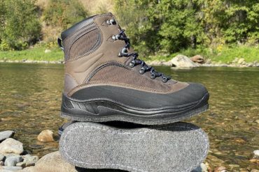 This photo shows the Cabela's Hiker Felt Sole Wading Boots next to a river.