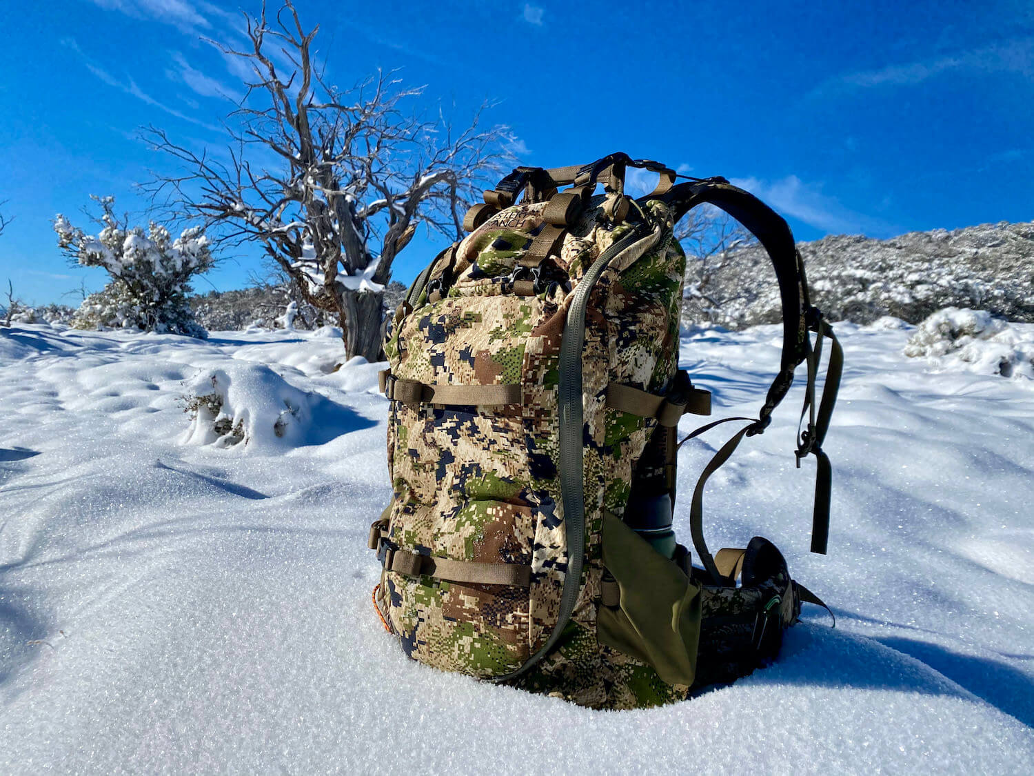 This review photo shows the Mystery Ranch Sawtooth 45 hunting backpack outside on a Nevada mountain during testing while hunting for elk.