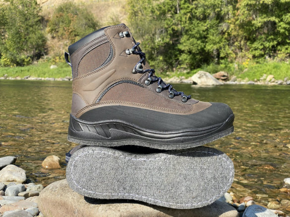 This photo shows the Cabela's Hiker Felt Sole Wading Boots near a river before testing during a fly fishing trip.