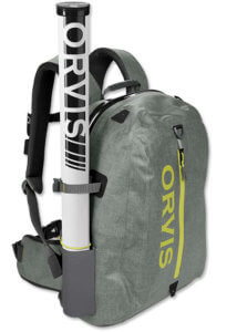 This best fishing backpack photo shows the Orvis Waterproof Backpack for fishing in wet conditions.