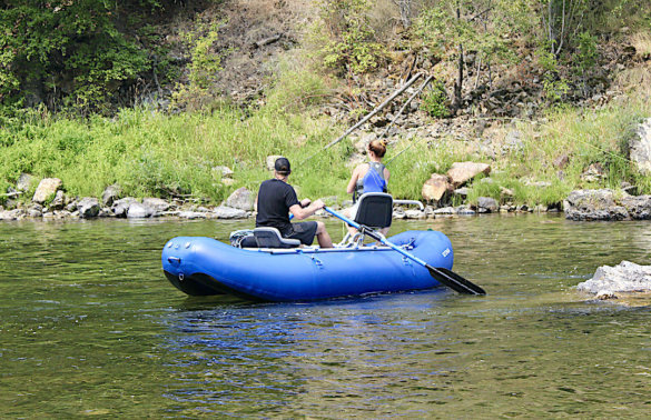 This photo shows two fly fishers fishing from the NRS STAR Wonder Bug Raft during the review process.