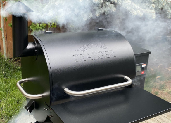 This photo shows the Traeger Pro 575 Pellet Grill with smoke during the testing and review process.