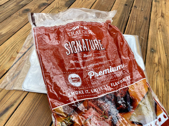 This photo shows a near empty bag of Traeger Signature Blend hardwood pellets.