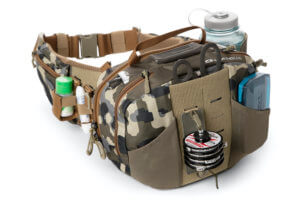 This fishing hip pack photo shows the Umpqua ZS2 Ledges 650 Waist Pack with fly fishing accessories attached.