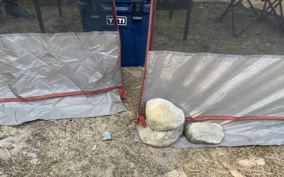 This photo shows the bottom of the zipper on the door of the Bass Pro Shops Eclipse Refuge Screen House during testing and review while camping.