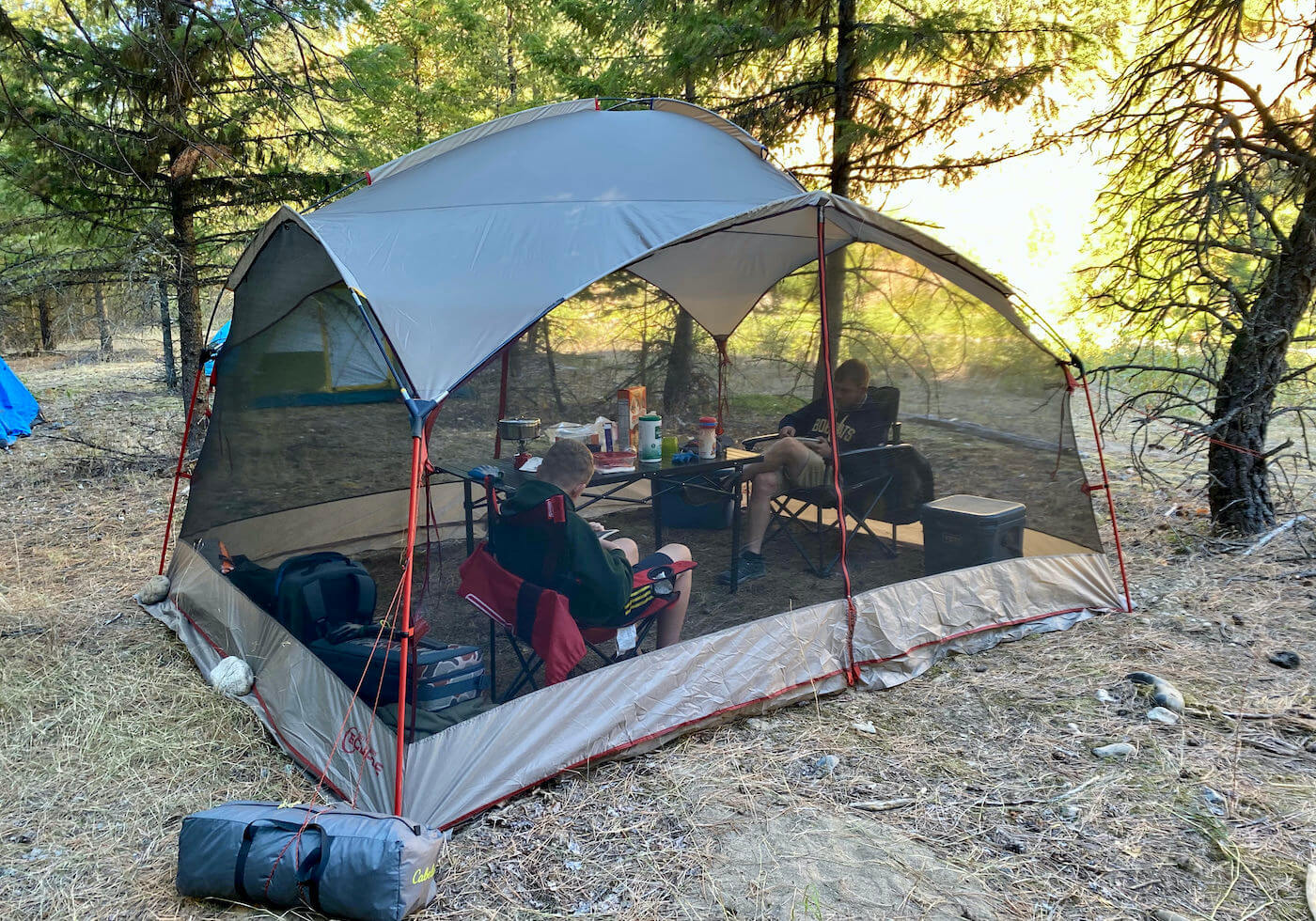 This testing and review photo shows the Bass Pro Shops Eclipse Refuge Screen House being used while camping.
