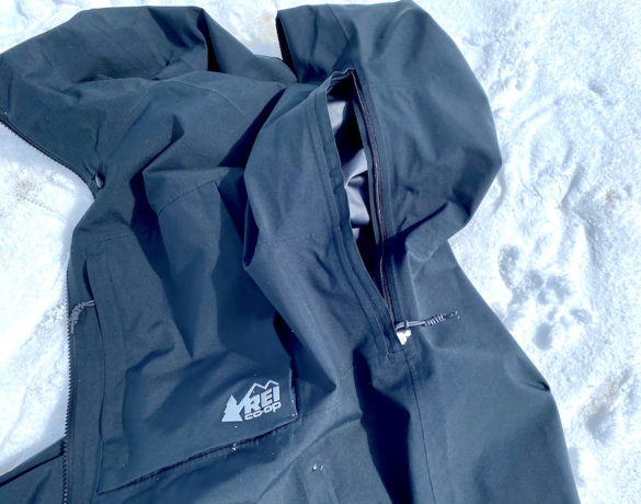 This photo shows the men's REI Co-op First Chair GTX Jacket's pit zips during testing on a ski hill.