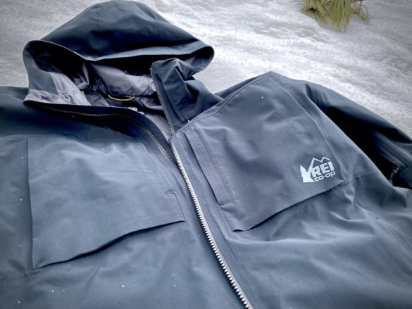 This photo shows the men's REI Co-op First Chair GTX Jacket on a ski hill.