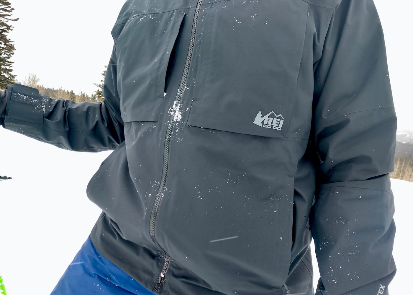This review photo shows the author wearing the men's REI Co-op First Chair GTX Jacket during testing while skiing.