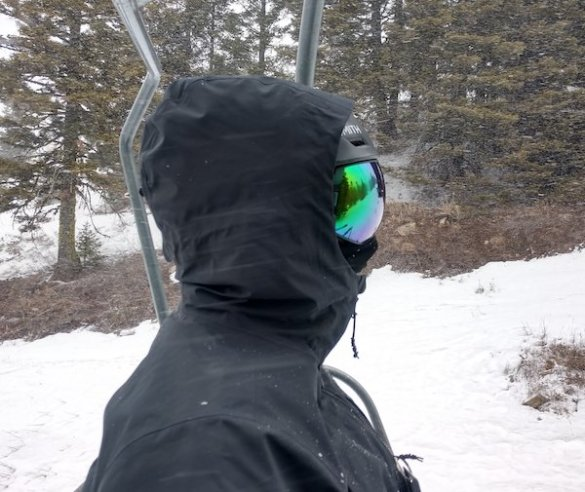 This photo shows the author wearing the men's REI Co-op First Chair GTX Jacket with the hood up while testing the jacket for this review.