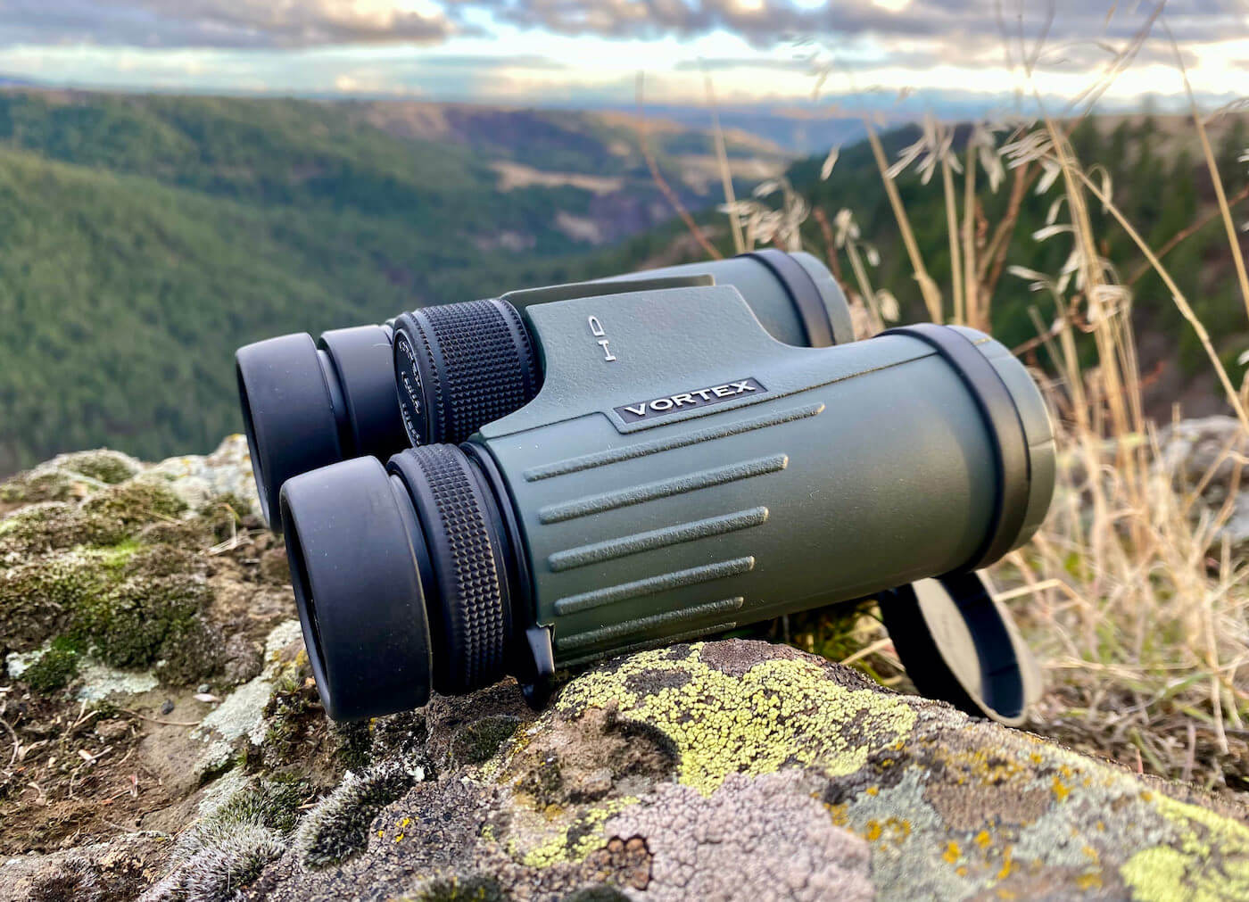 This review photo shows the author's Vortex Viper HD 10x42 binoculars outside during a hunting trip.