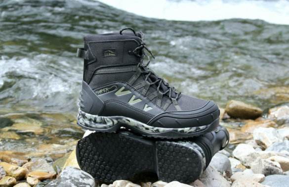This review photo shows the men's L.L.Bean Apex Wading Boots near the edge of a river during the review and testing process.