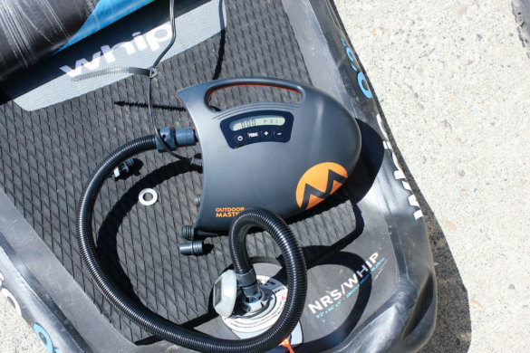 This photo shows the Outdoor Master The Shark II SUP Electric Air Pump deflating an inflatable SUP.