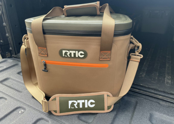 This review photo shows the RTIC Soft Pack 30 Cooler on the tailgate of a pickup truck.