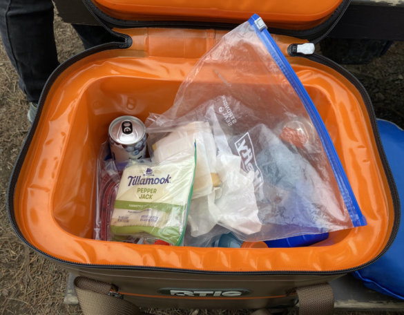 This review photo shows the RTIC Soft Pack 30 Cooler full of lunch food and drinks during the testing process.