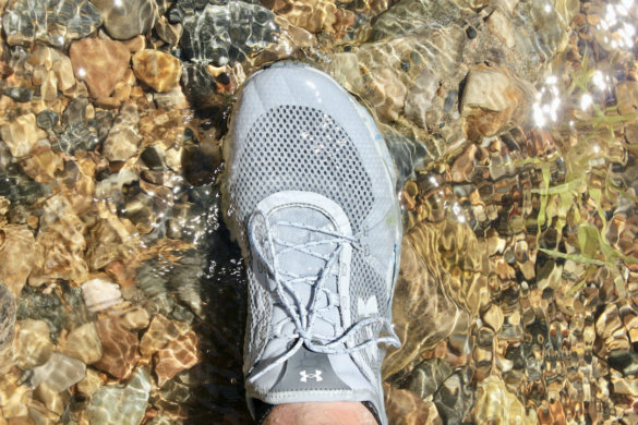 This photo shows the author wearing the UA Kilchis Fishing Shoes during the testing and review process at a river.