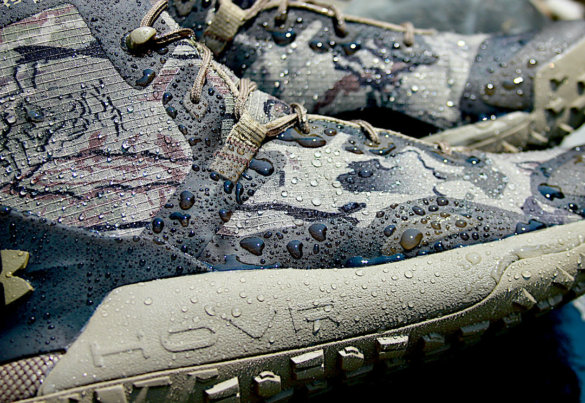 This photo shows the side of the UA HOVR Dawn Boots with water beading up on the outer boot.