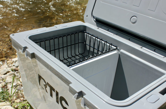 This photo shows the interior of the RTIC Ultra-Light Cooler with the included rim basket and ice-pack divider.