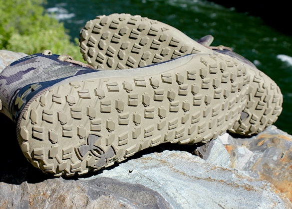 This photo shows the traction soles of the UA HOVR Dawn WP Boots.