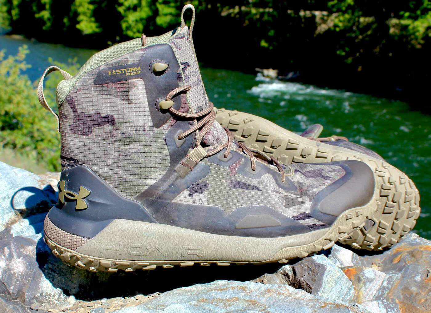 This review photo shows the Under Armour UA HOVR Dawn WP Boots on a rock during the initial testing phase by the author.