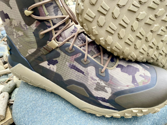 This photo shows a close up of the Under Armour UA HOVR Dawn WP Boot laces and uppers.