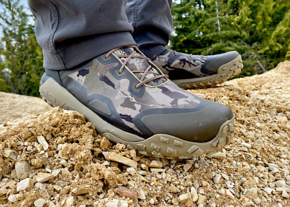 This review photo shows the author wearing the Under Armour UA HOVR Dawn WP Boots while testing the boots on a hike.