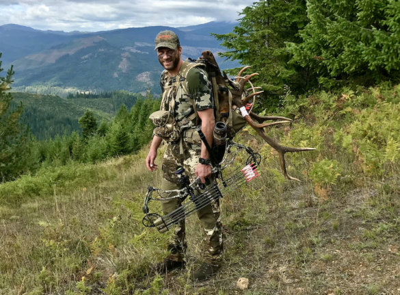 This photo shows the author wearing mis-matched hunting camo while packing out an elk in the backcountry.
