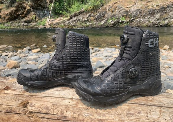This photo shows the UA CH1 Boots near a river.