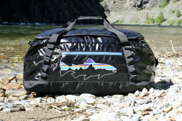 This review photo shows the Patagonia Black Hole Duffel Bag near a river during the testing process.