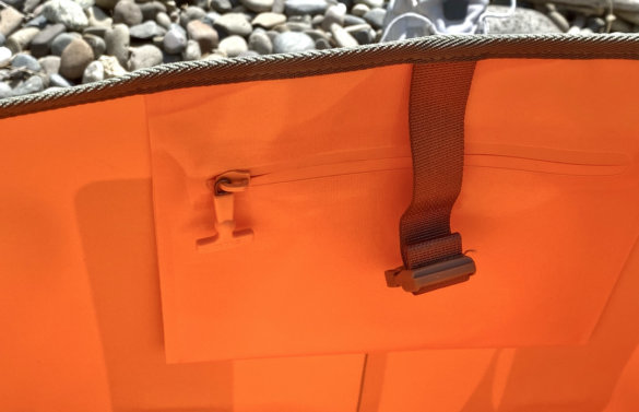 This photo shows the RTIC Tote Bag's interior stash pocket.