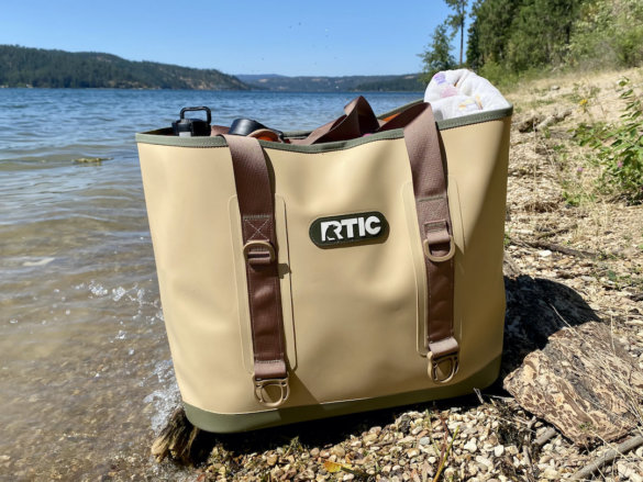 This photo shows the RTIC Tote Bag near a lake during the testing and review process.