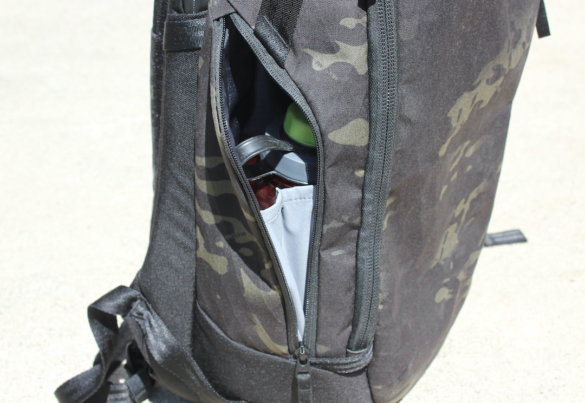 This photo shows the Able Carry Max Backpack with a 32 oz Nalgene water bottle inside the water bottle pocket.