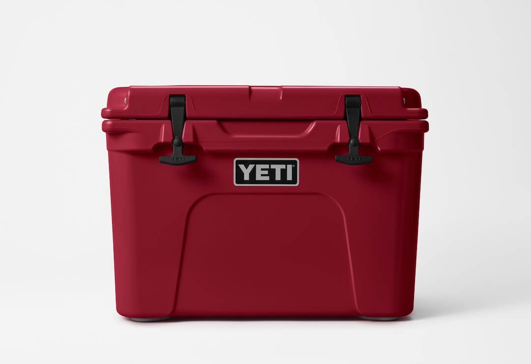 This photo shows the YETI Tundra 65 cooler in the Harvest Red color option.