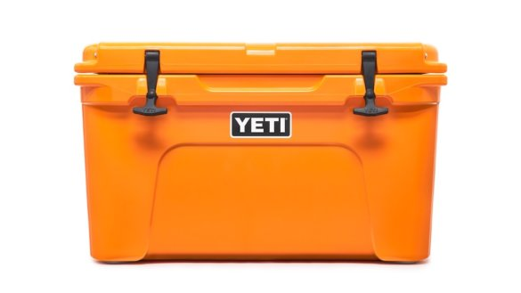This photo shows the YETI Tundra 45 cooler in the King Crab Orange color option.