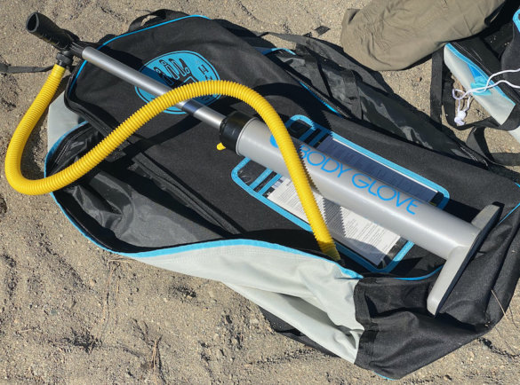 This photo shows the included high-pressure ISUP pump and carry backpack bag.