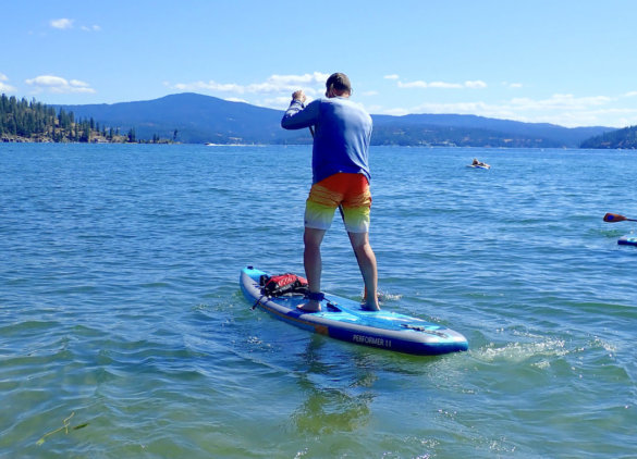 This photo shows the author paddling the Body Performer 11 on a lake during the testing and review process.