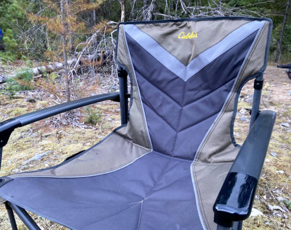 This photo shows the Cabela's Big Outdoorsman XL Fold-up Chair setup at a camping site during the testing and review process.