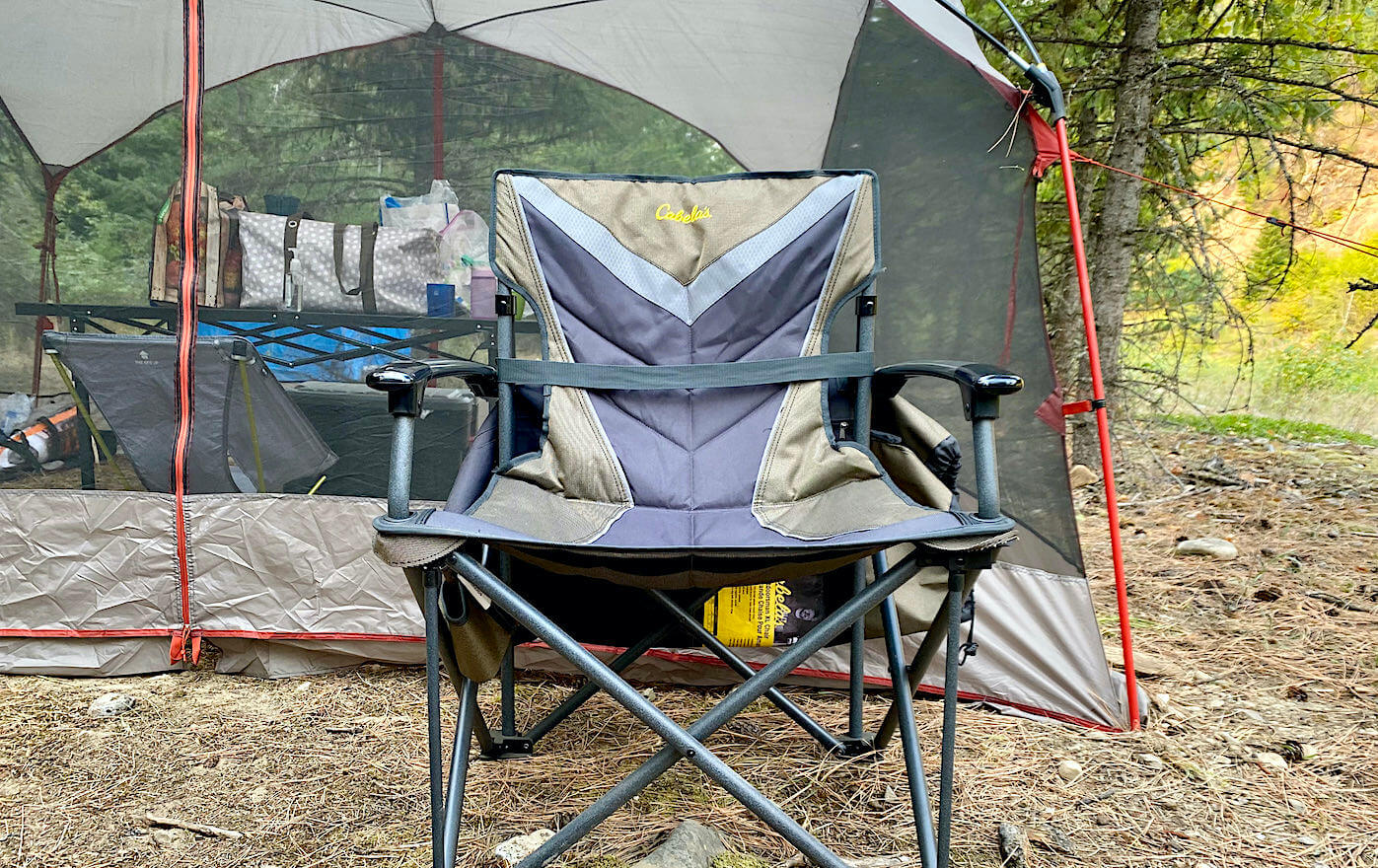 This photo shows the Cabela's Big Outdoorsman XL Fold-up Chair set up at a camping site.
