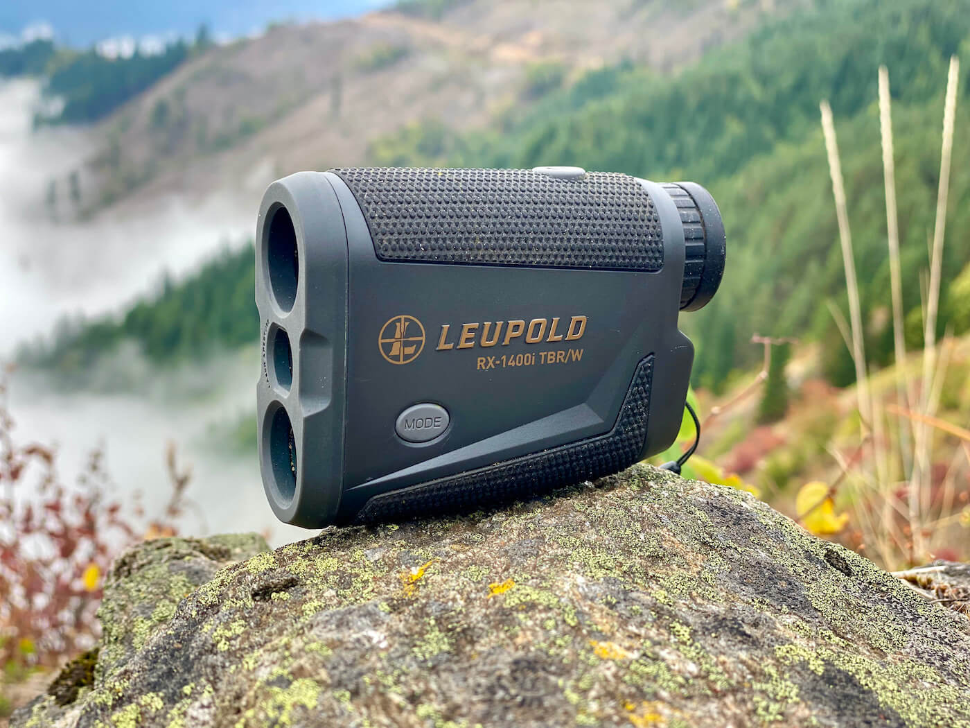 This review photo shows the Leupold RX-1400i TBR/W Rangefinder outside on a rock.